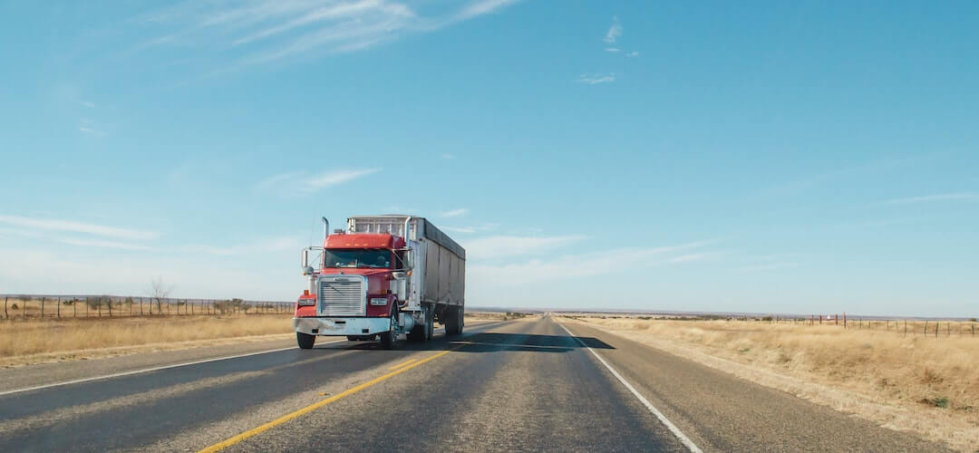 tractor trailer driving on the open road