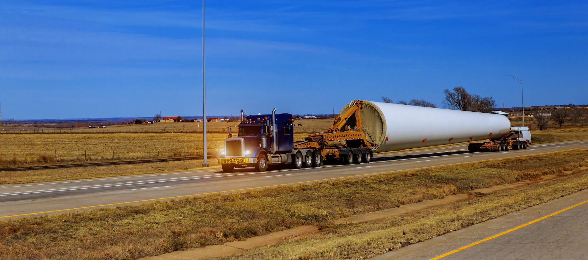 Heavy haul truck transporting wind turbine on highway