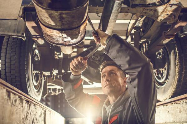 Mechanic working in truck repair shop