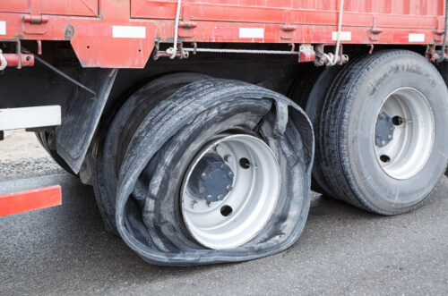 Tractor trailer with a flat tire